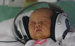 baby wearing headphones